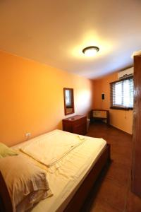 A bed or beds in a room at Easylife Aruba