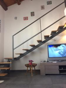 A television and/or entertainment center at Kalshouse Rizzo