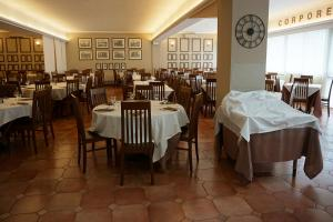 A restaurant or other place to eat at Hotel Marc'Aurelio