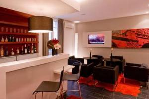 The lounge or bar area at Bailli De Suffren
