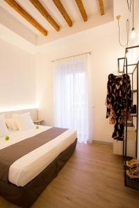 A bed or beds in a room at S30 Reina Victoria