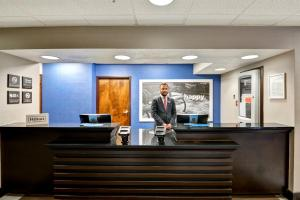 The lobby or reception area at Hampton Inn State College