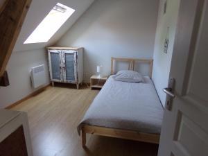 Un ou plusieurs lits dans un hébergement de l'établissement L'acacias
