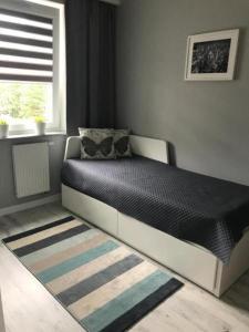 Łóżko lub łóżka w pokoju w obiekcie Apartamenty Leśne Tarasy