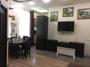 Телевизор и/или развлекательный центр в Apartment Tatiana