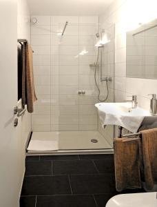 Ein Badezimmer in der Unterkunft Scheid´s Hotel – Restaurant