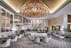 A restaurant or other place to eat at Cordis, Auckland by Langham Hospitality Group