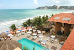 A view of the pool at Visual Praia Hotel or nearby