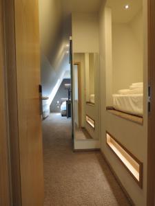 Ein Bett oder Betten in einem Zimmer der Unterkunft Hotel Neuthor