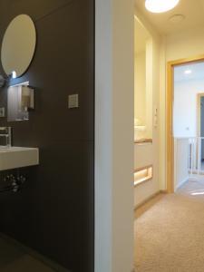Ein Badezimmer in der Unterkunft Hotel Neuthor