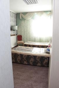 Кровать или кровати в номере Отель Ландыши