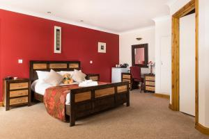 A bed or beds in a room at Spanhoe Lodge