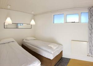 A bed or beds in a room at Keflavik Apartment