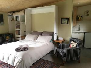 A bed or beds in a room at The Nook