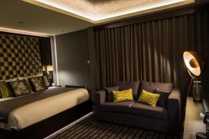 Кровать или кровати в номере Mondo Hotel