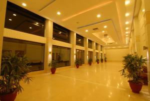 The lobby or reception area at Chanakya Bnr Hotel