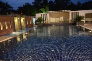 The swimming pool at or near Chanakya Bnr Hotel