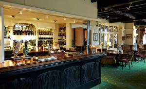 The lounge or bar area at Roebuck by Greene King Inns