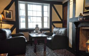 A seating area at Bell Hotel by Greene King Inns