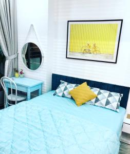 A bed or beds in a room at Livin Home Nha Trang