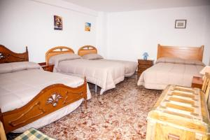 Cama o camas de una habitación en Casa Rural José María