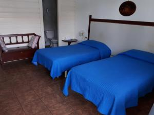 A bed or beds in a room at Residencial La Terraza