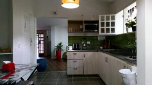 A kitchen or kitchenette at Hostel Macondo Guest House Medellín