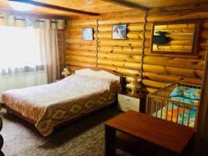 Кровать или кровати в номере Гостиничный комплекс Вертикаль