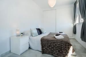 Cama o camas de una habitación en The Ivy Penthouse