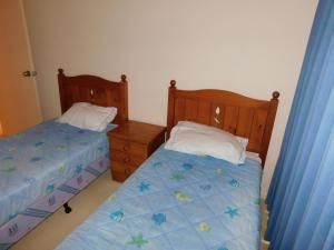 A bed or beds in a room at Horizons Golf Club, Unit 17, Horizons Drive