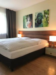 Ein Bett oder Betten in einem Zimmer der Unterkunft Apartmenthaus Sonnen