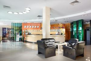 The lobby or reception area at Victoria Hotel & Business centre Minsk