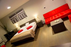 A bed or beds in a room at Gloria hotel