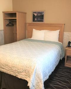A bed or beds in a room at Silver Spruce Inn