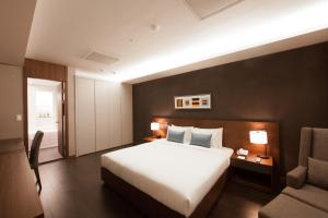 A bed or beds in a room at Fraser Place Central Seoul