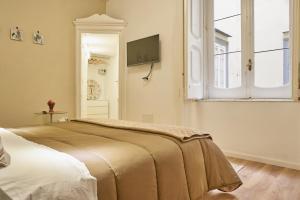 Cama o camas de una habitación en Donna Mariella