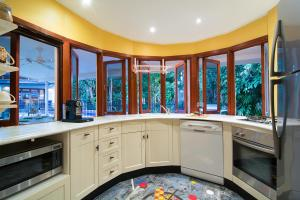 A kitchen or kitchenette at Mistral Tropical Beach House