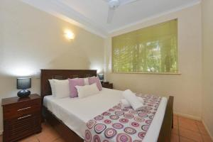 A bed or beds in a room at Seascape Holidays - Tropic Sands