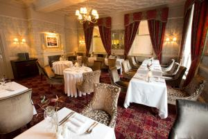 A restaurant or other place to eat at The George Hotel, Sure Hotel Collection by Best Western