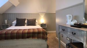 A bed or beds in a room at The Townhouse Sutton