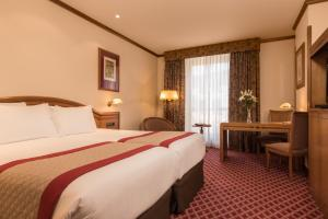 A bed or beds in a room at Eurostars Las Claras