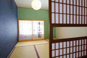 A bunk bed or bunk beds in a room at Yoshimura