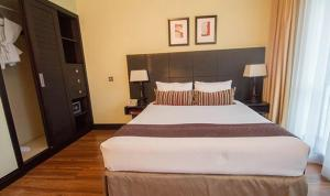 A bed or beds in a room at Mount Meru Hotel
