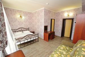 A bed or beds in a room at Guest House Zhemchuzhina mysa