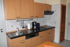 Een keuken of kitchenette bij Ferienwohnungen im Gästehaus Sieberns
