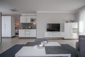 TV/Unterhaltungsangebot in der Unterkunft Apartmenthaus Am Fließ