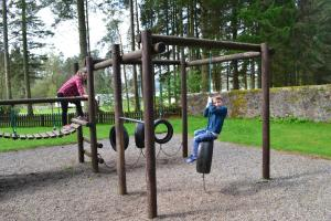 Children's play area at Callander Woods Holiday Park