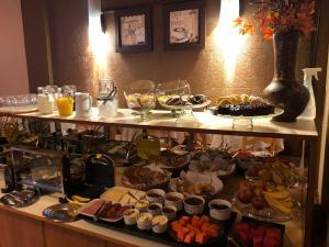Um restaurante ou outro lugar para comer em Pousada Encantos de Gramado