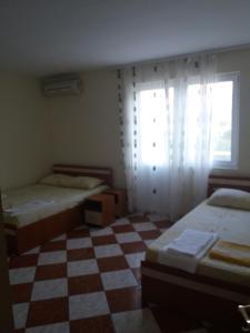Un pat sau paturi într-o cameră la Vila Sunset