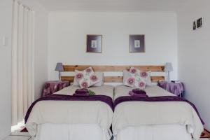 A bed or beds in a room at At Whale-Phin Guest House